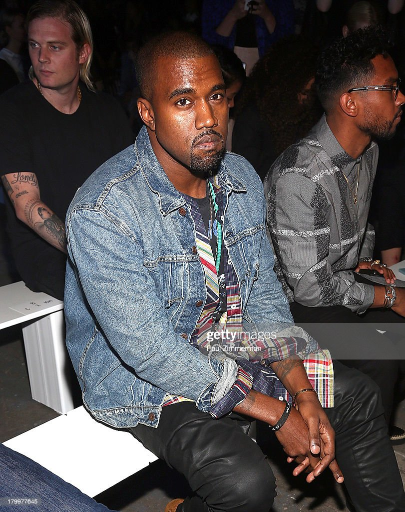 Musician <a gi-track='captionPersonalityLinkClicked' href=/galleries/search?phrase=Kanye+West+-+Musicista&family=editorial&specificpeople=201803 ng-click='$event.stopPropagation()'>Kanye West</a> attends the Alexander Wang show during Spring 2014 Mercedes-Benz Fashion Week at Pier 94 on September 7, 2013 in New York City.