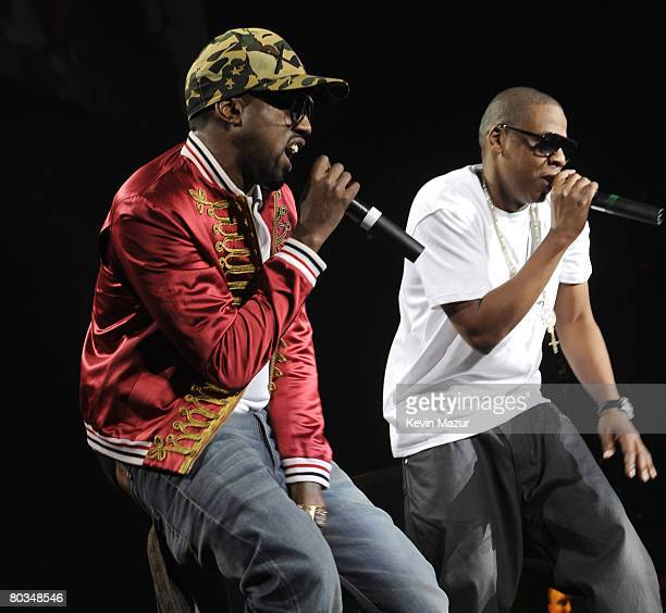 MIAMI MARCH 22 Musician Kanye West performs with JayZ during 'The Heart of the City' tour at American Airlines Arena on March 22 2008 in Miami...