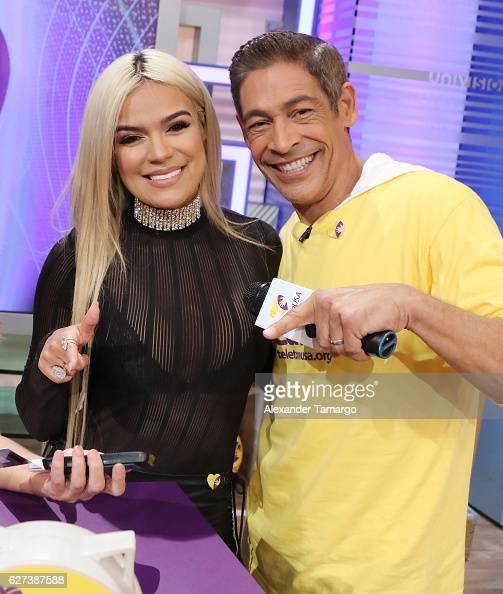 Musician Karol G and Johnny Lozada are seen during Univision's Teleton 2016 at Univision Studios on December 3 2016 in Miami Florida