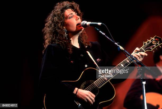 Musician Kathy Mattea performs onstage at Farm Aid in Indianapolis Indiana April 7 1990