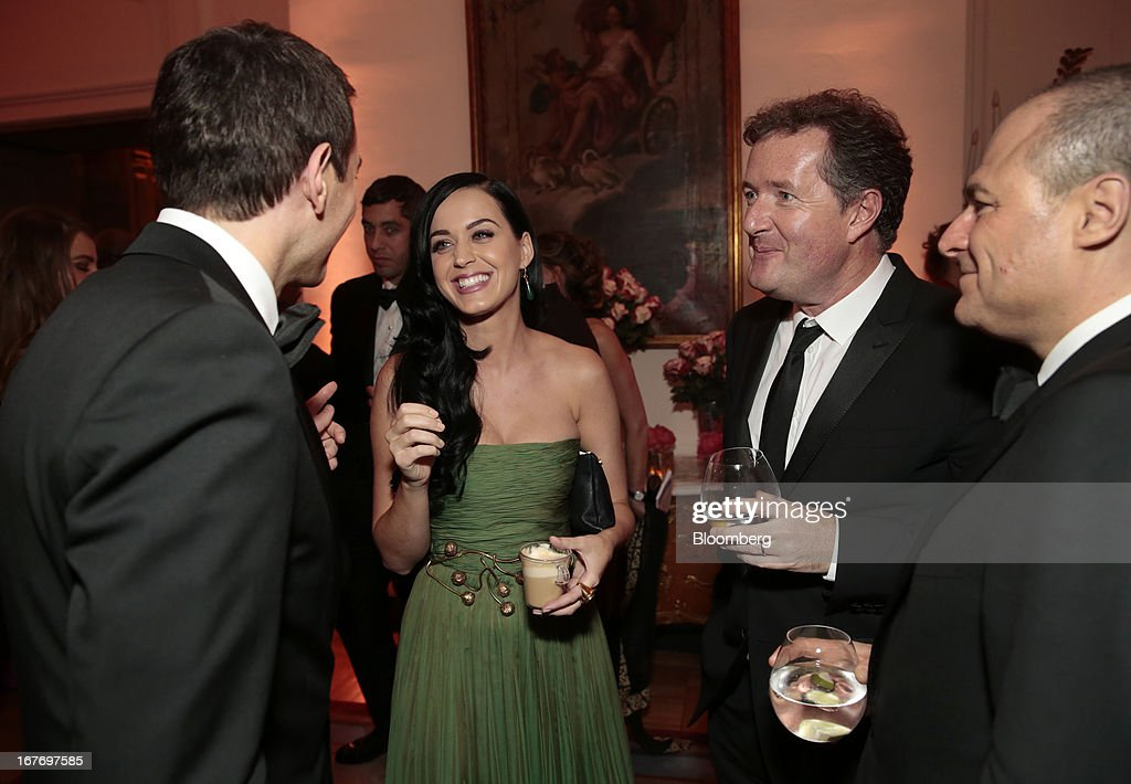 Musician Katy Perry, center left, and television host Piers Morgan, center right, attend the Bloomberg Vanity Fair White House Correspondents' Association (WHCA) dinner afterparty in Washington, D.C., U.S., on Saturday, April 27, 2013. The 99th annual dinner raises money for WHCA scholarships and honors the recipients of the organization's journalism awards. Photographer: Andrew Harrer/Bloomberg via Getty Images