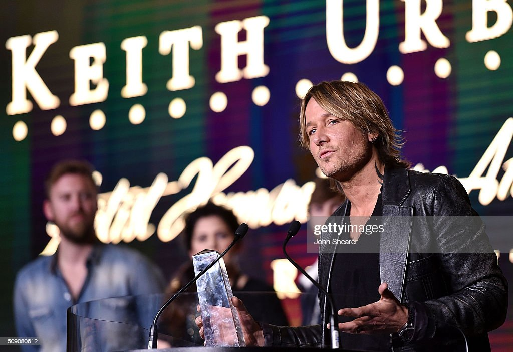 Musician <a gi-track='captionPersonalityLinkClicked' href=/galleries/search?phrase=Keith+Urban&family=editorial&specificpeople=202997 ng-click='$event.stopPropagation()'>Keith Urban</a> accepts the Artist Humanitarian Award during the CRS 2016 at Omni Hotel on February 8, 2016 in Nashville, Tennessee.