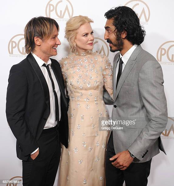 Musician Keith Urban actors Nicole Kidman and Dev Patel arrive at the 28th Annual Producers Guild Awards at The Beverly Hilton Hotel on January 28...