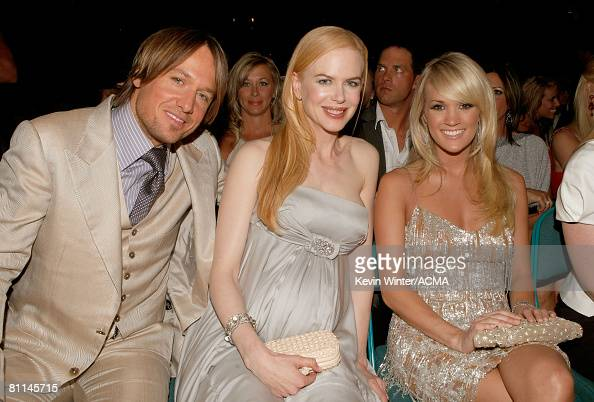 ACCESS*** Musician Keith Urban Actress Nicole Kidman and Singer Carrie Underwood onstage during the 43rd annual Academy Of Country Music Awards held...