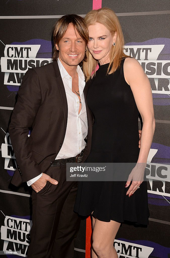 Musician <a gi-track='captionPersonalityLinkClicked' href=/galleries/search?phrase=Keith+Urban&family=editorial&specificpeople=202997 ng-click='$event.stopPropagation()'>Keith Urban</a> and actress <a gi-track='captionPersonalityLinkClicked' href=/galleries/search?phrase=Nicole+Kidman&family=editorial&specificpeople=156404 ng-click='$event.stopPropagation()'>Nicole Kidman</a> arrive at the 2013 CMT Music Awards at the Bridgestone Arena on June 5, 2013 in Nashville, Tennessee.