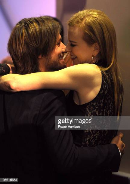Musician Keith Urban and actress Nicole Kidman celebrate in the audience during the People's Choice Awards 2010 held at Nokia Theatre LA Live on...