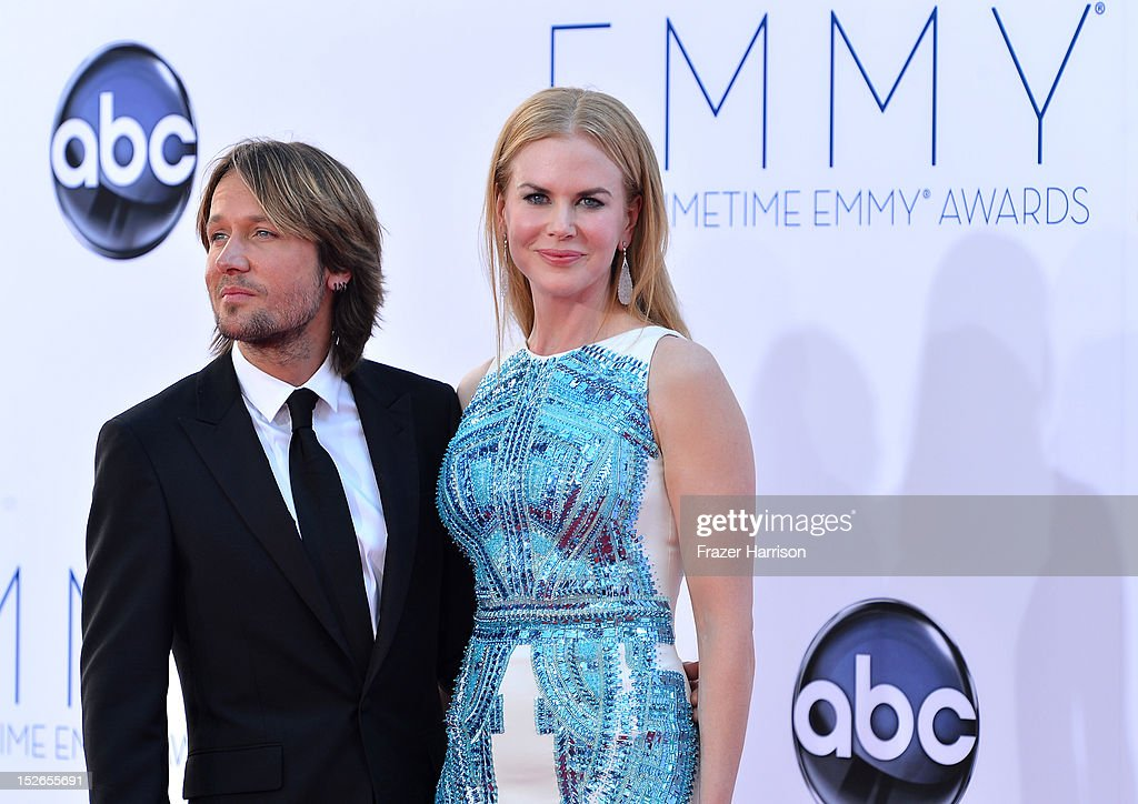 Musician <a gi-track='captionPersonalityLinkClicked' href=/galleries/search?phrase=Keith+Urban&family=editorial&specificpeople=202997 ng-click='$event.stopPropagation()'>Keith Urban</a> (L) and wife actress <a gi-track='captionPersonalityLinkClicked' href=/galleries/search?phrase=Nicole+Kidman&family=editorial&specificpeople=156404 ng-click='$event.stopPropagation()'>Nicole Kidman</a> arrive at the 64th Annual Primetime Emmy Awards at Nokia Theatre L.A. Live on September 23, 2012 in Los Angeles, California.