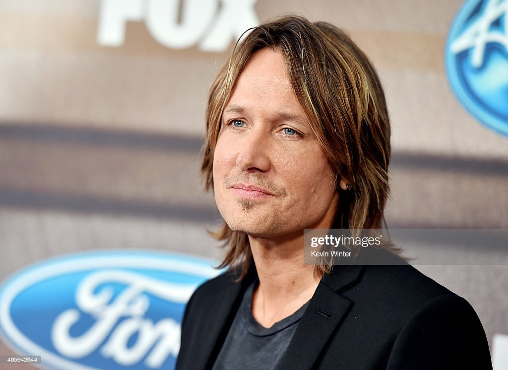 Musician <a gi-track='captionPersonalityLinkClicked' href=/galleries/search?phrase=Keith+Urban&family=editorial&specificpeople=202997 ng-click='$event.stopPropagation()'>Keith Urban</a> arrives at Fox TV's 'American Idol XIV' finalist party at The District on March 11, 2015 in Los Angeles, California.