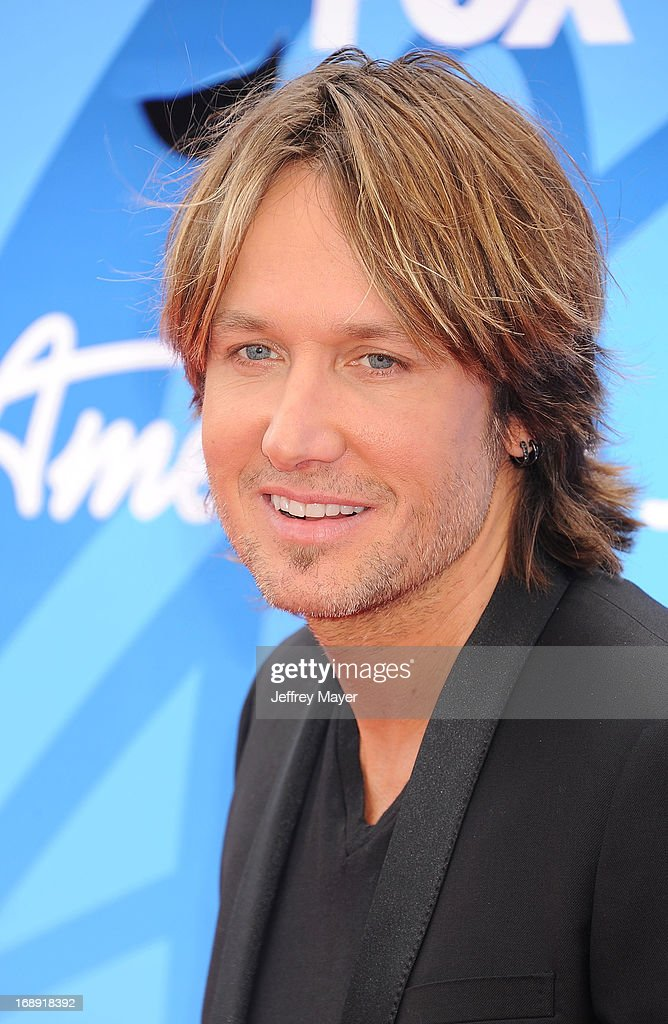 Musician <a gi-track='captionPersonalityLinkClicked' href=/galleries/search?phrase=Keith+Urban&family=editorial&specificpeople=202997 ng-click='$event.stopPropagation()'>Keith Urban</a> arrives at FOX's 'American Idol' Grand Finale at Nokia Theatre L.A. Live on May 16, 2013 in Los Angeles, California.
