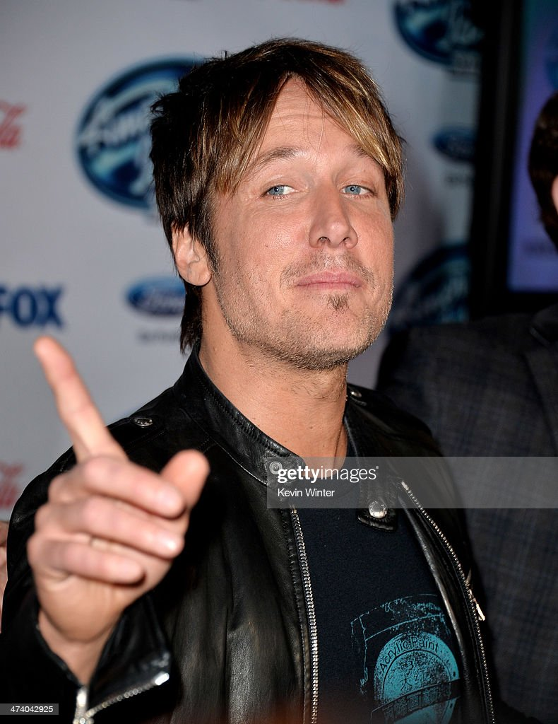 Musician <a gi-track='captionPersonalityLinkClicked' href=/galleries/search?phrase=Keith+Urban&family=editorial&specificpeople=202997 ng-click='$event.stopPropagation()'>Keith Urban</a> arrives at Fox's 'American Idol Xlll' Finalists Party at Fig and Olive on February 20, 2014 in West Hollywood, California.