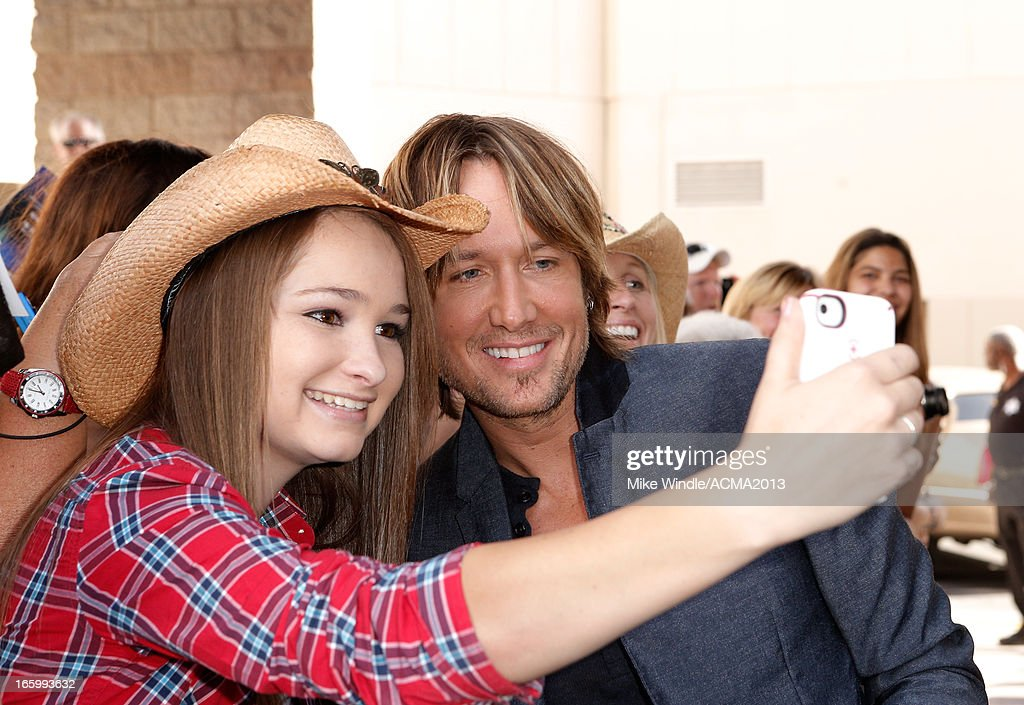 Musician Keith Urban (R) attends the 48th Annual Academy of Country Music Awards at the MGM Grand Garden Arena on April 7, 2013 in Las Vegas, Nevada.
