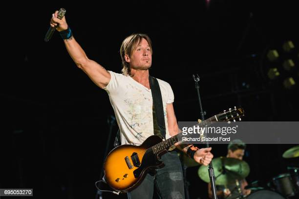 Musician Keith Urban performs at Nissan Stadium during day 4 of the 2017 CMA Music Festival on June 11 2017 in Nashville Tennessee