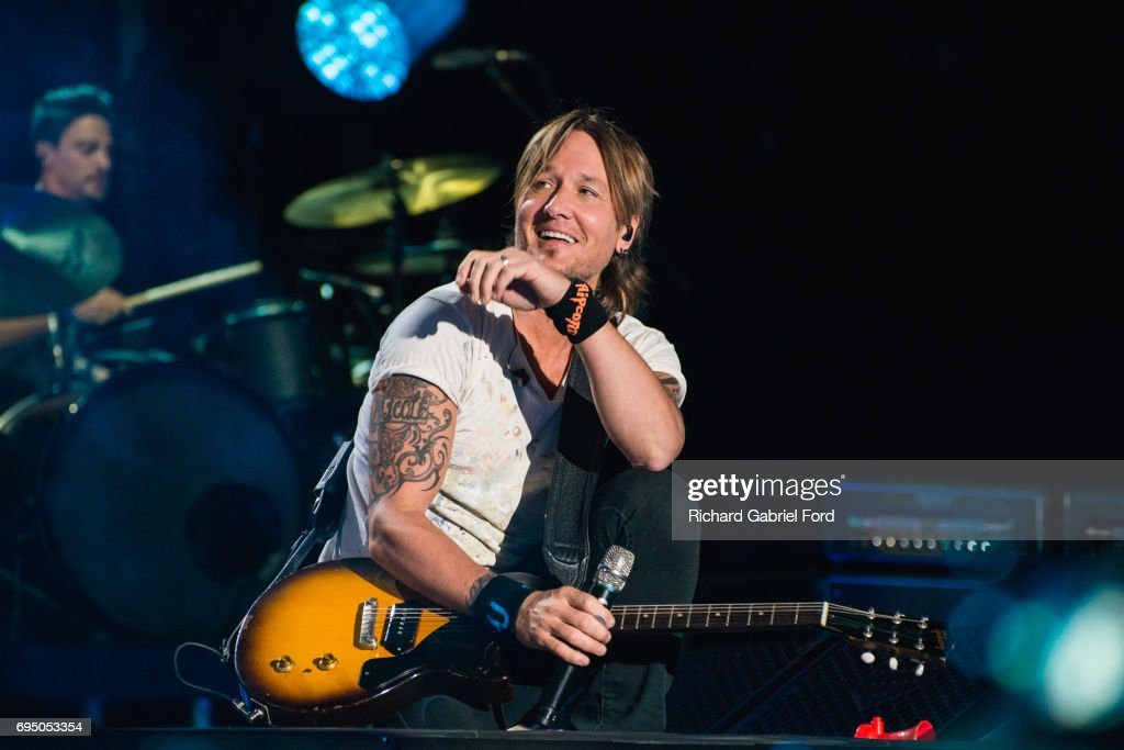 Musician Keith Urban performs at Nissan Stadium during day 4 of the 2017 CMA Music Festival on June 11, 2017 in Nashville, Tennessee.
