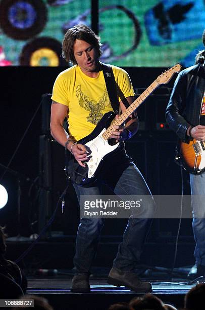 Musician Keith Urban performs onstage at the 44th Annual CMA Awards at the Bridgestone Arena on November 10 2010 in Nashville Tennessee