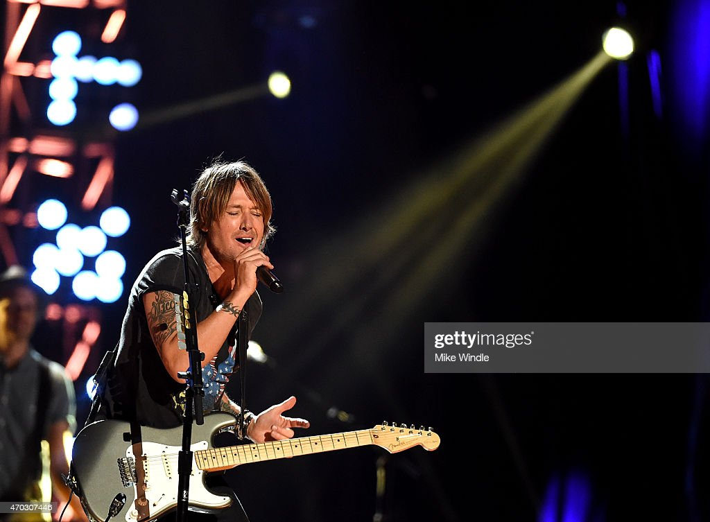 Musician Keith Urban performs onstage during ACM Presents: Superstar Duets at Globe Life Park in Arlington on April 18, 2015 in Arlington, Texas.