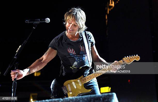 Musician Keith Urban performs onstage during ACM Presents Superstar Duets at Globe Life Park in Arlington on April 18 2015 in Arlington Texas