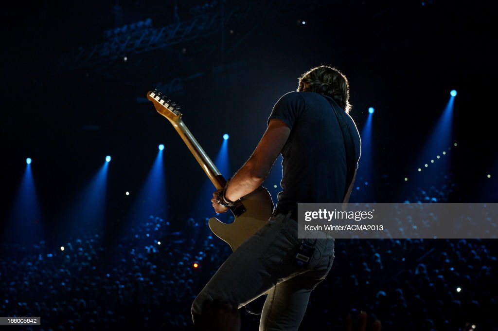 Musician <a gi-track='captionPersonalityLinkClicked' href=/galleries/search?phrase=Keith+Urban&family=editorial&specificpeople=202997 ng-click='$event.stopPropagation()'>Keith Urban</a> performs onstage during the 48th Annual Academy of Country Music Awards at the MGM Grand Garden Arena on April 7, 2013 in Las Vegas, Nevada.