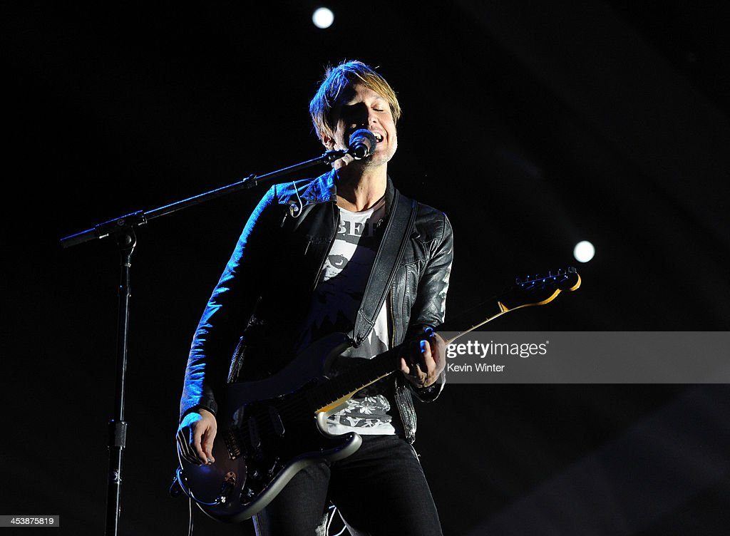 Musician <a gi-track='captionPersonalityLinkClicked' href=/galleries/search?phrase=Keith+Urban&family=editorial&specificpeople=202997 ng-click='$event.stopPropagation()'>Keith Urban</a> performs onstage during the rehearsals for The GRAMMY Nominations Concert Live!! Countdown to Music's Biggest Night at Nokia Theatre L.A. Live on December 5, 2013 in Los Angeles, California.