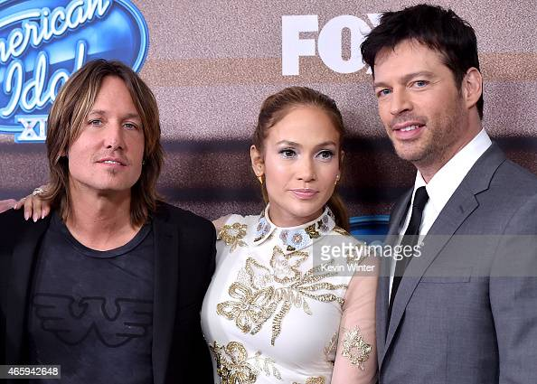 Musician Keith Urban singer/actress Jennifer Lopez and musician Harry Connick Jr arrive at Fox TV's 'American Idol XIV' finalist party at The...