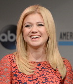 Musician Kelly Clarkson poses onstage at the 2013 American Music Awards Nominations Press Conference at BB King Blues Club Grill on October 10 2013...