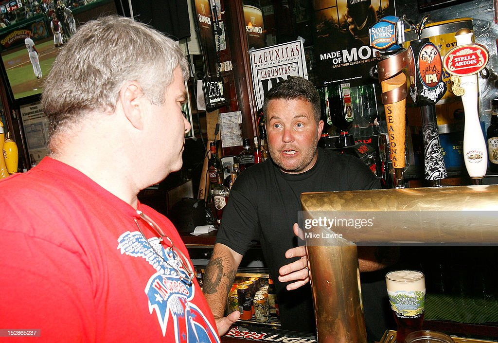 Musician Ken Casey of Dropkick Murphys guest bartends as part of a Super Bowl XLVI wager at Foley's NY Pub on September 27, 2012 in New York City. Casey, who owns McGreevy's Bar in Boston, lost a Super Bowl bet to Foley's owner Shaun Clauncy.
