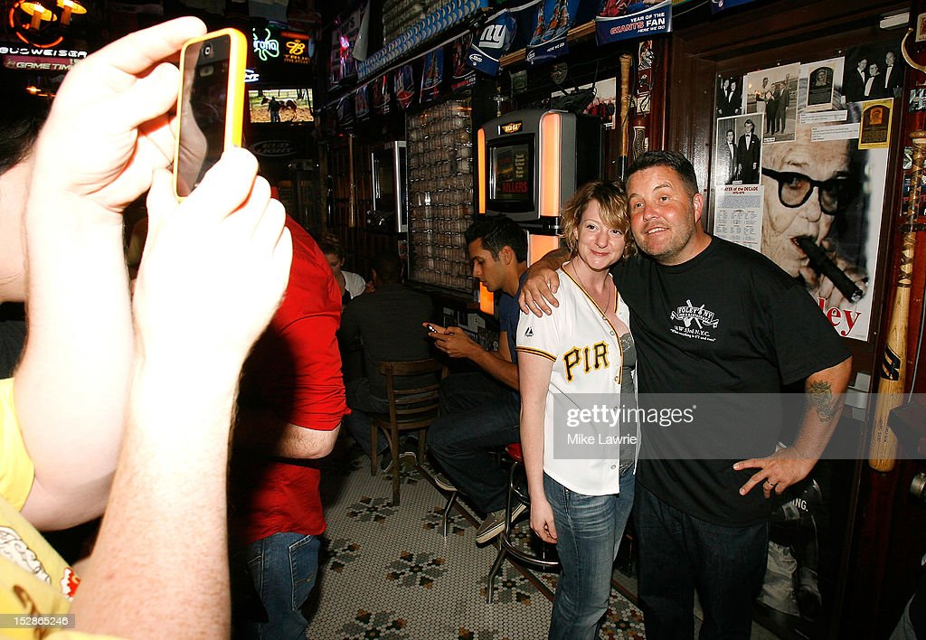 Musician Ken Casey of Dropkick Murphys poses with a fan as he guest bartends as part of a Super Bowl XLVI wager at Foley's NY Pub on September 27, 2012 in New York City. Casey, who owns McGreevy's Bar in Boston, lost a Super Bowl bet to Foley's owner Shaun Clauncy.
