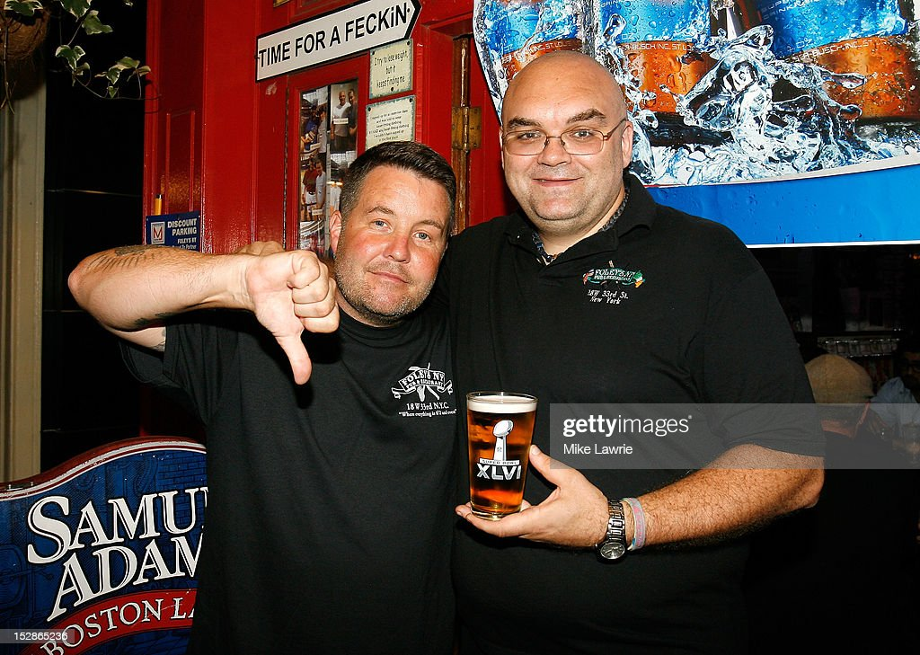 Musician Ken Casey (L) of Dropkick Murphys poses with Foley's owner Shaun Clancy as Casey guest bartends as part of a Super Bowl XLVI wager at Foley's NY Pub on September 27, 2012 in New York City. Casey, who owns McGreevy's Bar in Boston, lost a Super Bowl bet to Foley's owner Shaun Clauncy.