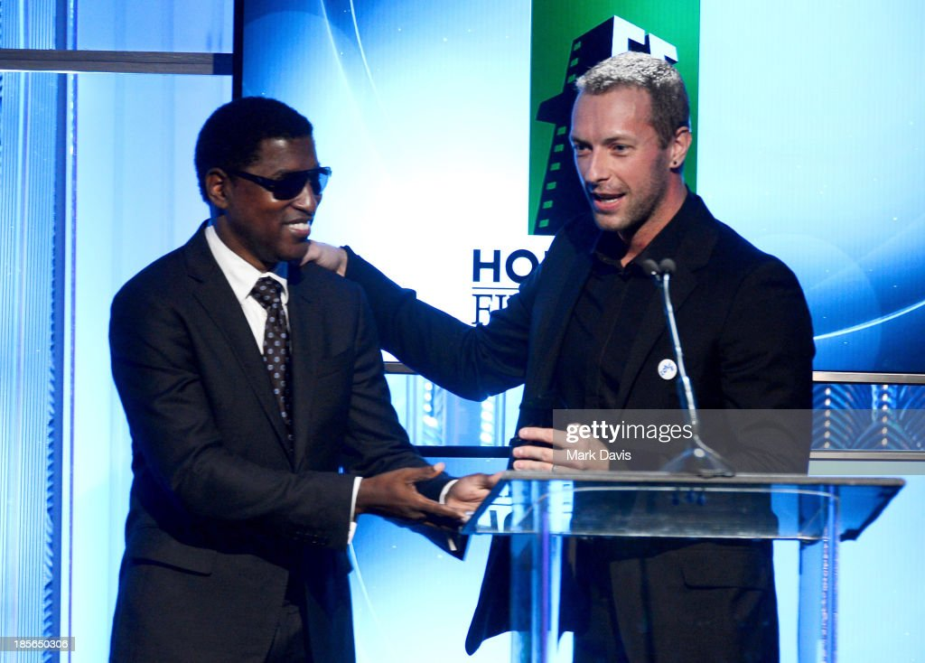 Musician Kenneth 'Babyface' Edmonds (L) and singer-songwriter <a gi-track='captionPersonalityLinkClicked' href=/galleries/search?phrase=Chris+Martin+-+Musician&family=editorial&specificpeople=4468181 ng-click='$event.stopPropagation()'>Chris Martin</a> speak onstage during the 17th annual Hollywood Film Awards at The Beverly Hilton Hotel on October 21, 2013 in Beverly Hills, California.