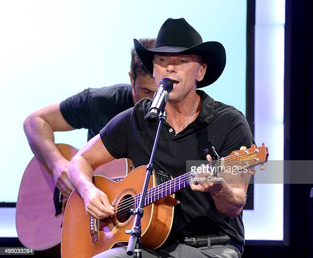 Musician Kenny Chesney performs onstage during the 29th American Cinematheque Award honoring Reese Witherspoon at the Hyatt Regency Century Plaza on...