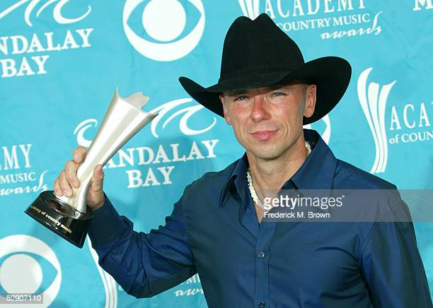 Musician Kenny Chesney winner of Entertainer of the Year Award poses in the press room at the 40th Annual Academy Country Music Awards at Mandalay...