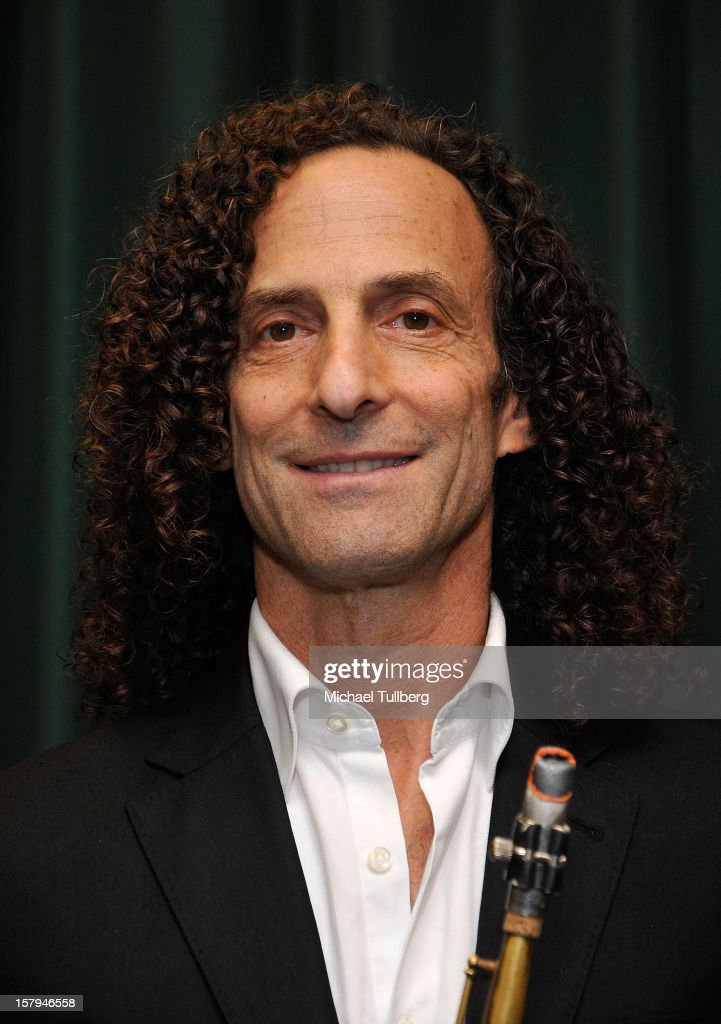 Musician <a gi-track='captionPersonalityLinkClicked' href=/galleries/search?phrase=Kenny+G&family=editorial&specificpeople=211357 ng-click='$event.stopPropagation()'>Kenny G</a> attends a reading of the new Christmas children's book 'ELFBOT' at The Americana at Brand on December 7, 2012 in Glendale, California.