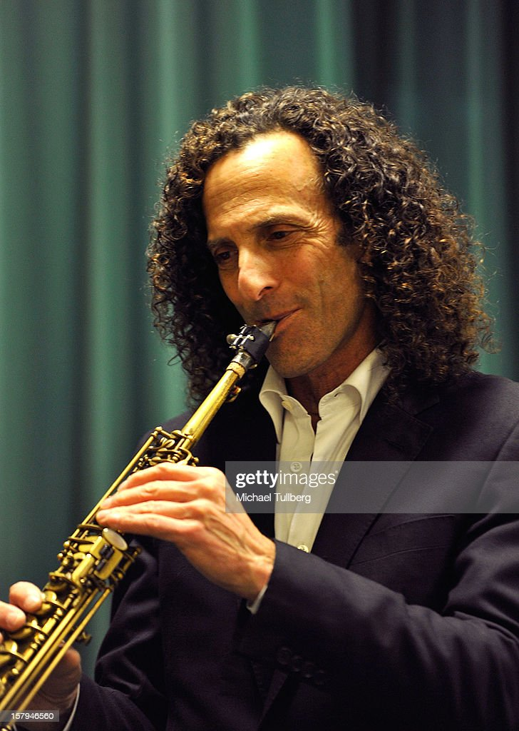 Musician <a gi-track='captionPersonalityLinkClicked' href=/galleries/search?phrase=Kenny+G&family=editorial&specificpeople=211357 ng-click='$event.stopPropagation()'>Kenny G</a> performs at a reading of the new Christmas children's book 'ELFBOT' at The Americana at Brand on December 7, 2012 in Glendale, California.