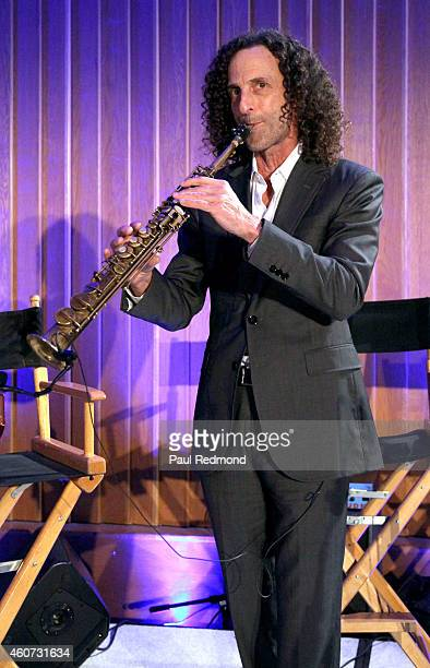 Musician Kenny G performs at the ISINA collaboration announcement at Capitol Recording Studios Holiday Party at Capitol Records Studio on December 17...