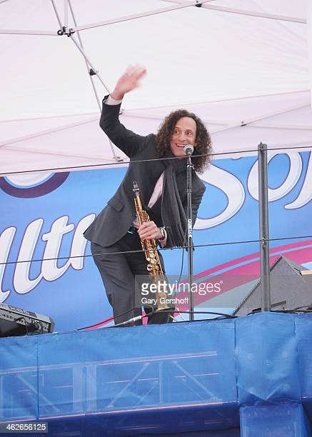 Musician Kenny G performs atop the Hard Rock Cafe Times Square marquee on January 14 2014 in New York City