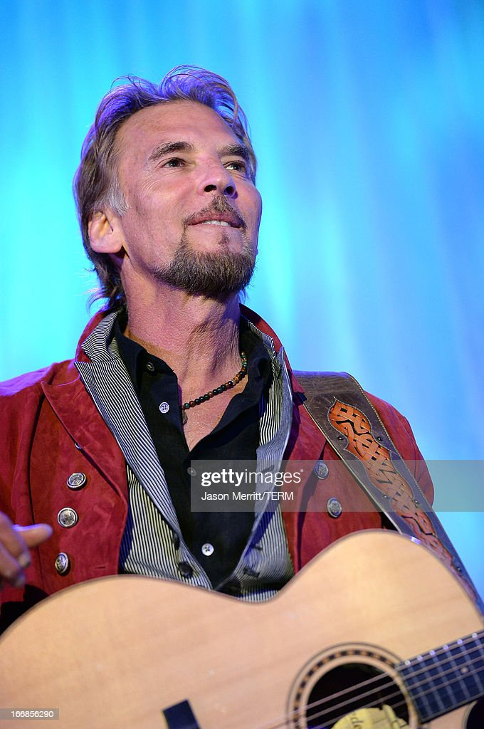 Musician <a gi-track='captionPersonalityLinkClicked' href=/galleries/search?phrase=Kenny+Loggins&family=editorial&specificpeople=640646 ng-click='$event.stopPropagation()'>Kenny Loggins</a> performs onstage during The Kaleidoscope Ball - Designing The Future benefitting the UCLA Children's Discovery and Innovation Institute at Mattel Children's Hospital UCLA at Beverly Hills Hotel on April 17, 2013 in Beverly Hills, California.