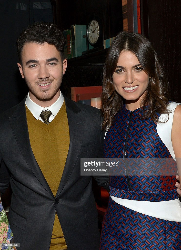 Musician Kevin Jonas and actress Nikki Reed pose backstage during the 5th Annual TeenNick HALO Awards at Hollywood Palladium on November 17, 2013 in Hollywood, California.