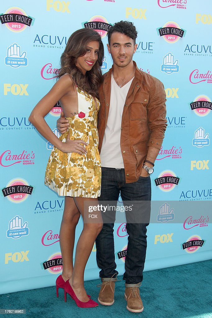 Musician <a gi-track='captionPersonalityLinkClicked' href=/galleries/search?phrase=Kevin+Jonas&family=editorial&specificpeople=709547 ng-click='$event.stopPropagation()'>Kevin Jonas</a> (R) and <a gi-track='captionPersonalityLinkClicked' href=/galleries/search?phrase=Danielle+Deleasa&family=editorial&specificpeople=6716653 ng-click='$event.stopPropagation()'>Danielle Deleasa</a> arrive at the Fox Teen Choice Awards 2013 held at the Gibson Amphitheatre on August 11, 2013 in Los Angeles, California.