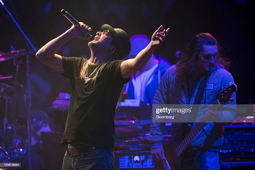 Musician <a gi-track='captionPersonalityLinkClicked' href=/galleries/search?phrase=Kid+Rock&family=editorial&specificpeople=171123 ng-click='$event.stopPropagation()'>Kid Rock</a>, left, performs during a campaign rally for Republican presidential candidate Mitt Romney at the Verizon Wireless Center in Manchester, New Hampshire, U.S., on Monday, Nov. 5, 2012. President Barack Obama beseeched core supporters and wayward backers to go to the polls, while Romney reached for an upset victory powered by anti-incumbent fervor on the final full day of a race that polls suggest has tilted slightly in the president's favor. Photographer: Andrew Harrer/Bloomberg via Getty Images Photographer: Andrew Harrer/Bloomberg via Getty Images
