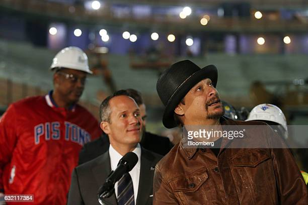 Musician Kid Rock right stands with Christopher Ilitch president and chief executive officer for Ilitch Holdings Inc during a press conference at the...