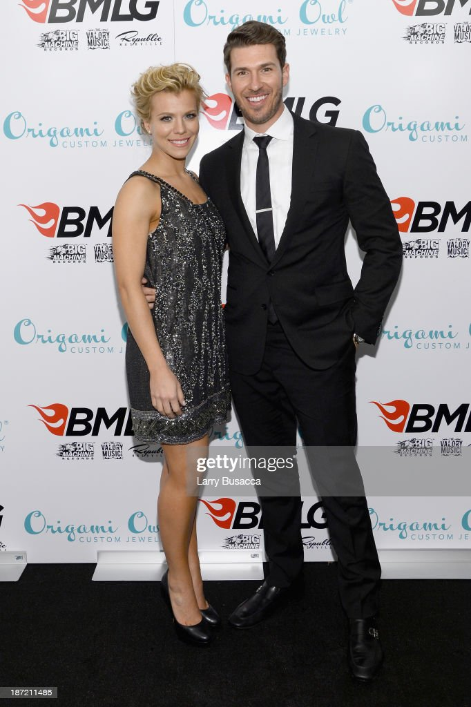 Musician Kimberly Perry of The Band Perry and professional baseball player J.P. Arencibia attend the Big Machine Label Group CMA Awards after party on November 6, 2013 in Nashville, Tennessee.