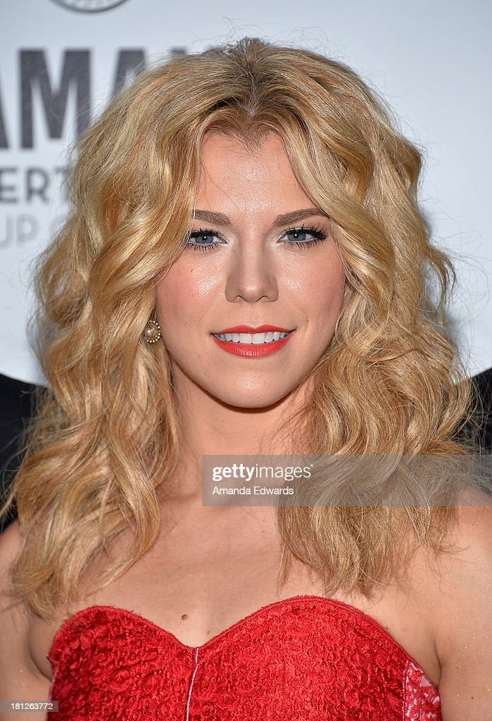 Musician <a gi-track='captionPersonalityLinkClicked' href=/galleries/search?phrase=Kimberly+Perry&family=editorial&specificpeople=6718325 ng-click='$event.stopPropagation()'>Kimberly Perry</a> of The Band Perry arrives at the 2nd Annual Beyond Hunger: A Place At The Table Benefit Honoring Susan Sarandon at Montage Beverly Hills on September 19, 2013 in Beverly Hills, California.
