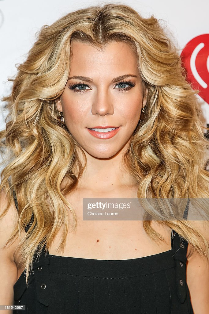 Musician <a gi-track='captionPersonalityLinkClicked' href=/galleries/search?phrase=Kimberly+Perry&family=editorial&specificpeople=6718325 ng-click='$event.stopPropagation()'>Kimberly Perry</a> of The Band Perry poses backstage at The Village during the iHeartRadio music festival on September 21, 2013 in Las Vegas, Nevada.