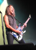 Musician Kirk Hammett of Metallica performs a secret concert in celebration of 'Metallica Through The Never' during ComicCon International 2013 at...