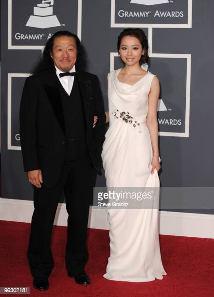 Musician Kitaro and Jane Zhang arrive at the 52nd Annual GRAMMY Awards held at Staples Center on January 31 2010 in Los Angeles California