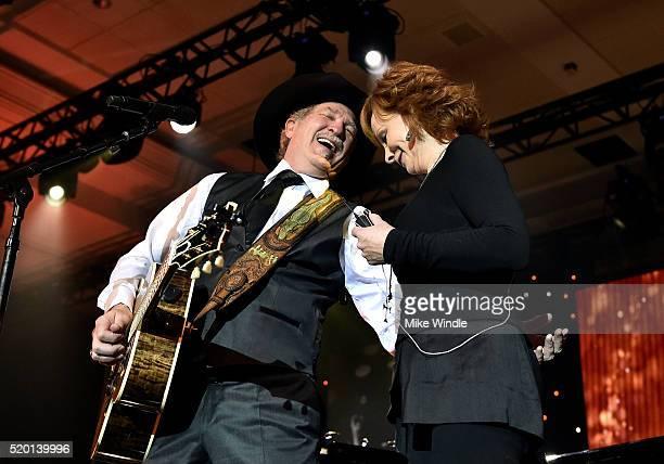 Musician Kix Brooks and singer Reba McEntire perform onstage during Muhammad Ali's Celebrity Fight Night XXII at the JW Marriott Phoenix Desert Ridge...