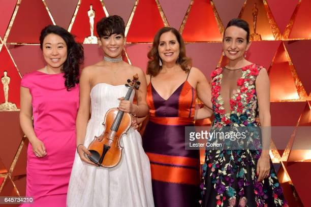 Musician Kokoe TanakaSuwan Brianna Perez and filmmakers Kahane Cooperman and Raphaela Neihausen attend the 89th Annual Academy Awards at Hollywood...