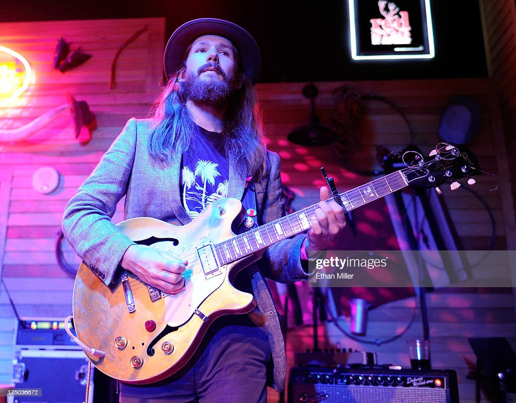 Musician Kyle Ryan performs with singer/songwriter Kacey Musgraves at Gilley's Saloon, Dance Hall & Bar-B-Que at the Treasure Island Hotel & Casino as she tours in support of the album 'Same Trailer Different Park' on July 29, 2013 in Las Vegas, Nevada.
