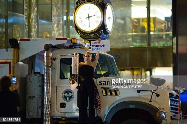 TOPSHOT Musician Lady Gaga stages a protest against Republican presidential nominee Donald Trump on a sanitation truck outside Trump Tower in New...