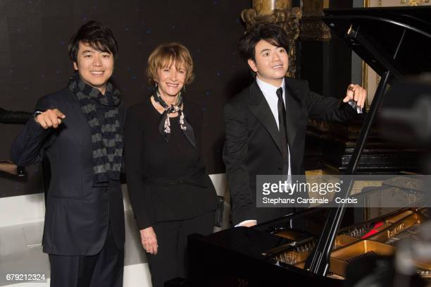 Musician Lang Lang poses with his Wax Figure and Eve Ruggieri at Musee Grevin on May 5 2017 in Paris France