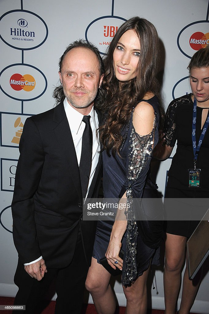 Musician Lars Ulrich (L) and model Jessica Miller attend the 56th annual GRAMMY Awards Pre-GRAMMY Gala and Salute to Industry Icons honoring Lucian Grainge at The Beverly Hilton on January 25, 2014 in Los Angeles, California.